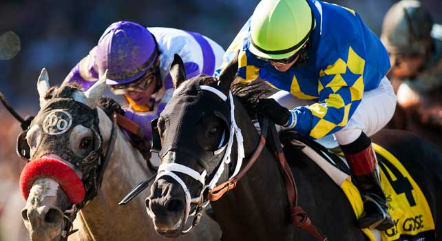 Shanghai Bobby and Rosie Napravnik (right) battle He's Had Enough and Mario Gutierrez to win the Breeders' Cup Juvenile at Santa Anita Park in Arcadia, California on November 3, 2012.