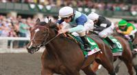 09 October 2011. Aruna and jockey Ramon Dominguez win the Juddmonte Spinster Stakes, GRI $500,000 for owner Flaxman Holdings, and trainer Graham Motion.
