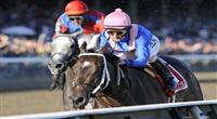 09 September 06: Hot Dixie Chick (no. 1), ridden by Robby Albarado and trained by Steve Asmussen, wins the 118th running of the grade 1 Spinaway Stakes for two year old fillies at Saratoga Race Track in Saratoga Springs, New York.