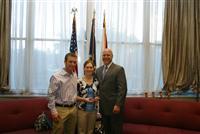 NOLA mayor Landrieu presents Rosie Napravnik and her husband Joe Sharp with the key to the city.