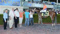 Cajun Sunrise in the Winners Circle after a Maiden Special Weight race at Gulfstream Park.