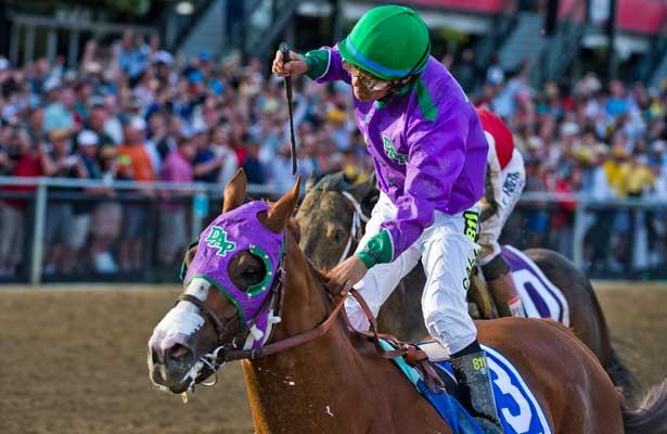 May 17, 2014: California Chrome, ridden by Victor Espinoza, wins the Preakness to keep Triple Crown hopes aliver on Preakness Day at Pimlico Race Course in Baltimore, MD. Jon Durr/ESW/CSM