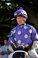 Jockey Charles C. Lopez