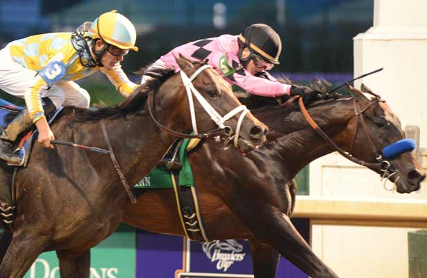 Code West (inside) and jockey Rosie Napravnik win the Matt Winn at Churchill Downs over Uncaptured (outside) and jockey for owners Gary and Mary West and trainer Bob Baffert; June 15, 2013