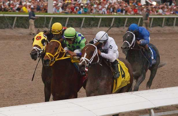 March 29, 2014: Jockey Javier Castellano and Constitution get by on the rail on the way to winning the Florida Derby(G1). Wildcat Red and John Velazquez fights gamely getting beat a neck. General a Rod with Juan Leyva were third while favorite Cairo Prince never threatened finishing 4th.Gulfstream Park in Hallandale Beach (FL). Arron Haggart/ESW/CSM