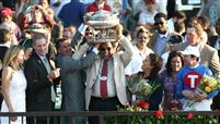 Owner K. K. Jayaraman and his wife celebrate Summer Bird's Belmont win with trainer Tim Ice, jockey Kent Desormeaux and NY Governor Patterson