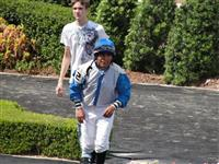 September 15, 2009: Jose Riquelme sprints back to the Jock's Room after the 5th race at Louisiana Downs.