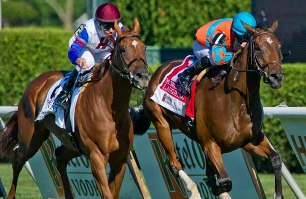 Laughing (1), ridden by Jose Lezcano, outduels Pianist (2), ridden by Mike Smith, to win the Ketel One Ballston Spa Stakes on Travers Stakes Day on Saratoga Race Course in Saratoga Springs, New York on August 24, 2013.