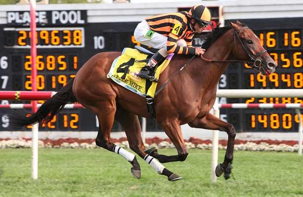 LITTLE MIKE and jockey Ramon A. Dominguez winning the Arlington Million at Arlington Park 8-18-12