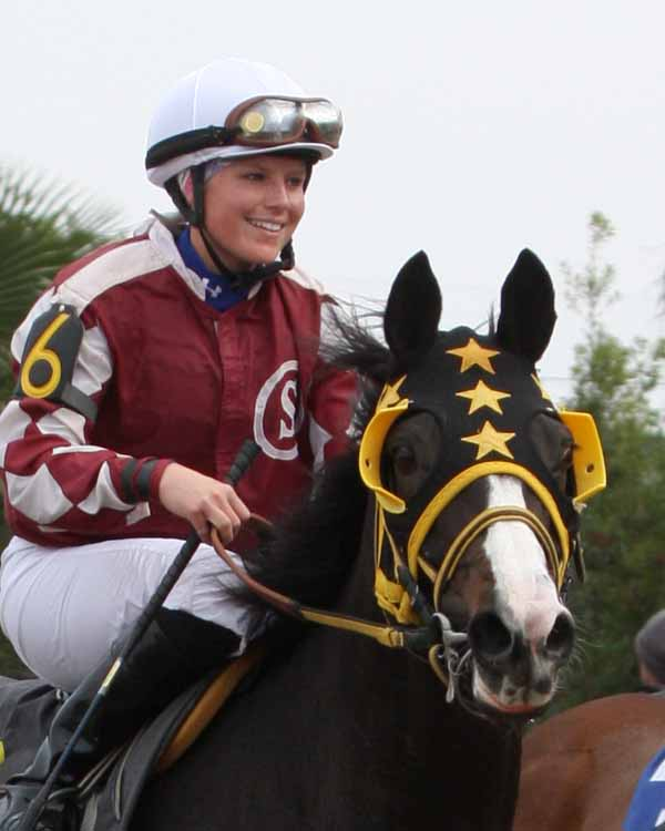 Anna is all smiles coming back to the Winner's Circle on her first Fair Grounds winner, Money Hill. 12-04-09