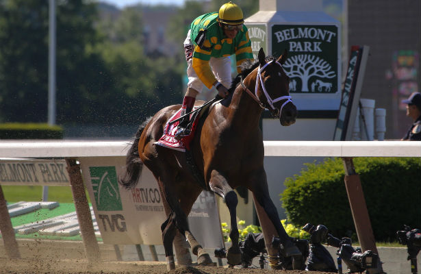 Palace Malice with John Velazquez aboard wins the Grade I Metropolitan at Belmont Park in Elmont, New York.