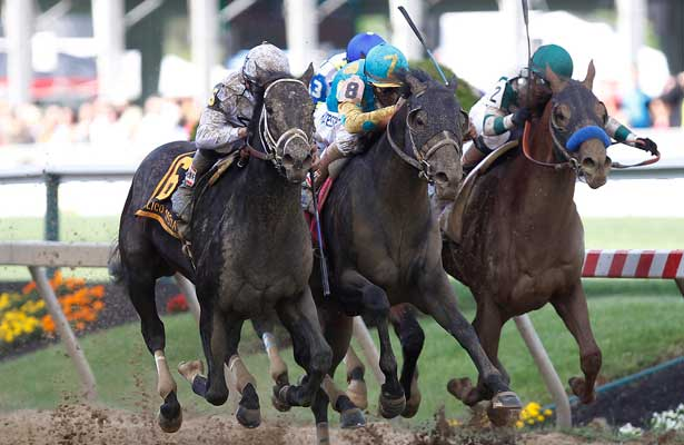 May 16, 2014: #6 Revolutionary (left), trained by Todd Pletcher and ridden by Mike Smith, wins the Gr III Pimlico Special at Pimlico Race Course in Baltimore, MD. #8 Prayer for Relief, center, was 2nd; #2Cat Burgler, right, was third. ©Joan Fairman Kanes/ESW/CSM