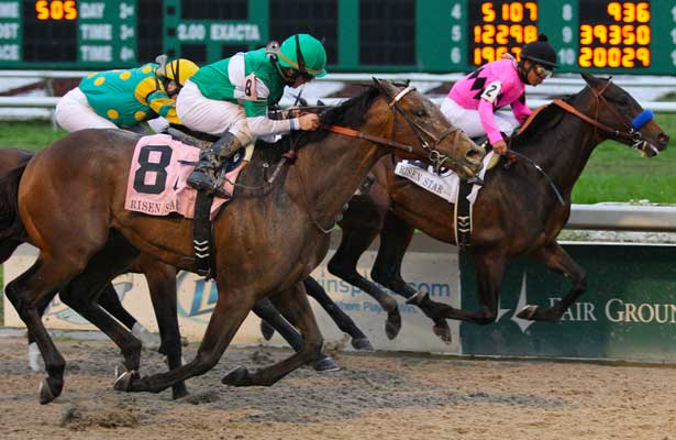 I've Struck a nerve ridden by James Graham edges out Code West (maegnta silks) to win the Risen Star Stakes Race at Fair Grounds Race Course in New Orleans, Louisiana on February 23, 2013. (( Special transmission of horses in the Top 25 for points for the 2013 KentuckyDerby ))