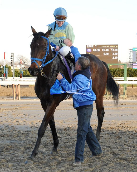 Jackie and Robbie Davis after Sandyinthesun's maiden win on December 3, 2011 at Aqueduct Racetrack