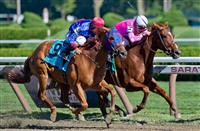 Sweet Lulu (5), ridden by Julien Leparoux, holds on to win the Test Stakes on Travers Stakes Day on Saratoga Race Course in Saratoga Springs, New York on August 24, 2013.