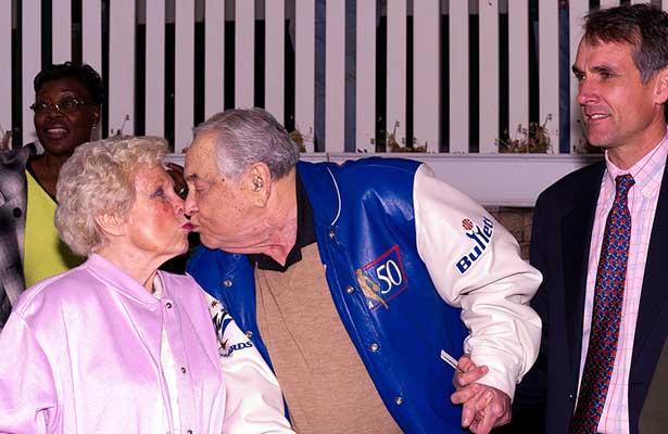 Sylvia & Arnold Heft share a kiss.