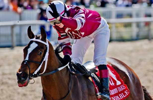 March 29, 2014: Untapable,ridden by Rosie Napravnik, wins the Fair Grounds Oak on Louisiana Derby Day at the Fairgrounds Race Course in New Orleans, LA. Scott Serio/ESW/CSM
