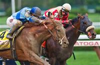 August 23, 2014: V.E. Day (4), ridden by Javier Castellano, catches Wicked Strong, ridden by Rajiv Maragh, at the wite to win the 145th running of the Travers Stakes on Travers Stakes Day at Saratoga Race Course in Saratoga Springs, New York. Scott Serio/ESW/CSM