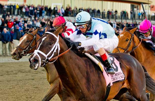 Verrazano, ridden by John Velazquez, outduels Normandy Invasion (red cap) and Vyjack (pink cap) to win the Wood Memorial Stakes on Wood Memorial Day at Aqueduct Race Track in Ozone Park, New York on April 6, 2013