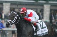 We Miss Artie and John Velazquez win the 100th running of The Dixiana Breeders' Futurity Grade 1 $400,000 at Keeneland Race Course for owner Kenneth and Sarah Ramsey, and trainer Todd Pletcher. October 05, 2013.