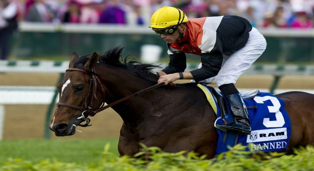 Banned and Garrett Gomez win the American Turf Stakes at Churchill Downs in Louisville, Kentucky May 7, 2011.