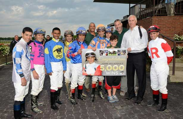 John Velazquez winning aboard Galloping Giraffe and of Velazquez and other members of the Belmont Park riding colony in the winner's circle.