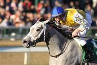 Sheer Beauty captures the 2009 Caressing stakes at Churchill Downs